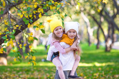 Adorable little girls have fun outdoors at Stock Photo