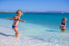 Adorable little girls have fun at tropical beach Stock Photo