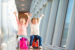 Adorable little girls having fun in airport Royalty Free Stock Photography