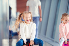 Adorable little girls having fun in airport Stock Photography