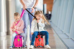 Adorable little girls having fun in airport Stock Image
