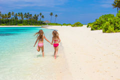 Adorable little girls having fun during beach Stock Photography