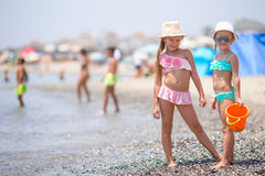 Adorable little girls having fun during beach Stock Image