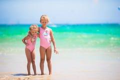 Adorable little girls having fun during beach Stock Photo