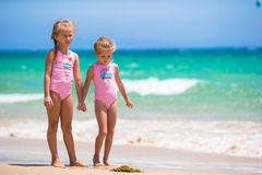 Adorable little girls having fun during beach Stock Images