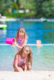 Adorable little girls having fun during beach Royalty Free Stock Images