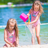 Adorable little girls having fun during beach Stock Photos