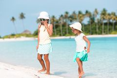 Adorable little girls having fun during beach vacation stock photography