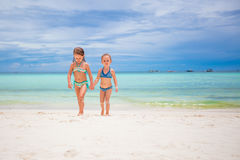 Adorable little girls having fun during beach vacation Royalty Free Stock Image
