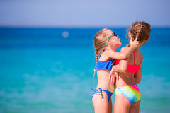 Adorable little girls having fun during beach vacation Stock Image