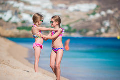 Adorable little girls having fun during beach vacation. Two kids together on greek vacation royalty free stock photos
