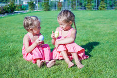Adorable little girls having fun with Easter Eggs Royalty Free Stock Photos