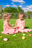 Adorable little girls having fun with Easter Eggs Royalty Free Stock Image