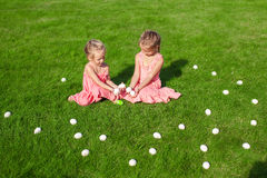 Adorable little girls having fun with Easter Eggs Stock Image