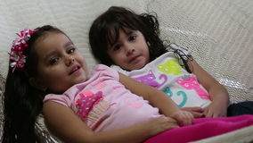 Adorable little girls lying in hammock. stock video footage