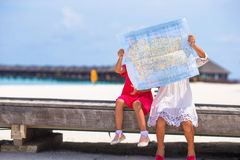 Adorable little girls with map of island on beach Stock Photo