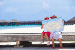 Adorable little girls with map of island on beach Royalty Free Stock Image
