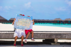 Adorable little girls with map of island on beach Stock Image