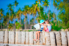 Adorable little girls with map of island on beach Royalty Free Stock Images