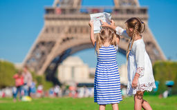 Adorable little girls with map of Paris background Stock Image