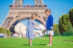 Adorable little girls with map of Paris background Stock Photography