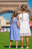 Adorable little girls with map of Paris background the Eiffel tower Stock Image