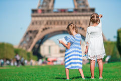 Adorable little girls with map of Paris background the Eiffel tower Stock Images