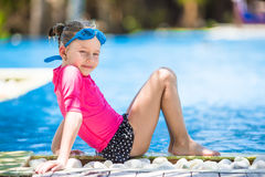 Adorable little girls at mask and goggles in Royalty Free Stock Image