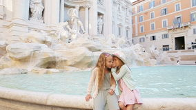 Adorable little girls near the Fountain of Trevi in Rome. Happy kids enjoy their european vacation in Italy stock footage