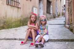 Adorable little girls outdoors in European city Stock Images