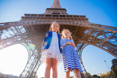 Adorable little girls in Paris background the Eiffel tower Stock Photos