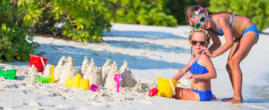 Adorable little girls playing with beach toys Stock Images