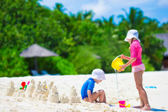 Adorable little girls playing with beach toys Stock Photography