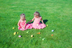 Adorable little girls playing with Easter Eggs on Stock Image