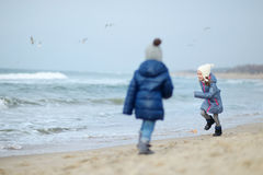 Adorable little girls playing by the ocean Stock Photography