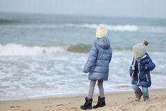 Adorable little girls playing by the ocean Royalty Free Stock Image