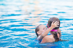Adorable little girls playing in outdoor swimming Royalty Free Stock Images