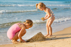 Adorable little girls playing at the seashore Royalty Free Stock Photography