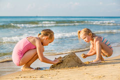 Adorable little girls playing at the seashore Royalty Free Stock Images