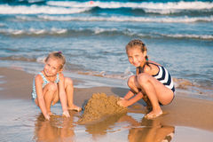 Adorable little girls playing at the seashore Royalty Free Stock Photo