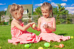 Adorable Little Girls Playing With Easter Eggs On Stock Images