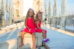 Adorable little girls on the rooftop of Duomo, Royalty Free Stock Image