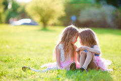 Adorable little girls on spring day outdoors royalty free stock photos