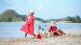 Adorable little girls during summer vacation on the beach. Adorable little girls during summer vacation on beach stock footage
