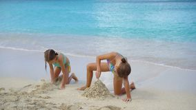 Adorable little girls during summer vacation on the beach. Adorable little girls during summer vacation on white beach stock video