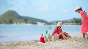 Adorable little girls during summer vacation on the beach. Adorable little girls during summer vacation on white beach stock video footage