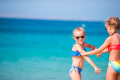 Adorable little girls during summer vacation. Kids enjoy their travel in Greece stock photo