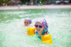 Adorable little girls swimming in clear sea Royalty Free Stock Photos