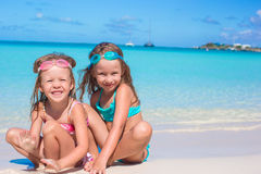 Adorable little girls in swimsuit and glasses for. Adorable girls in swimsuit and glasses for swimming at tropical beach Royalty Free Stock Photo