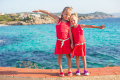 Adorable little girls at tropical beach during Royalty Free Stock Photos